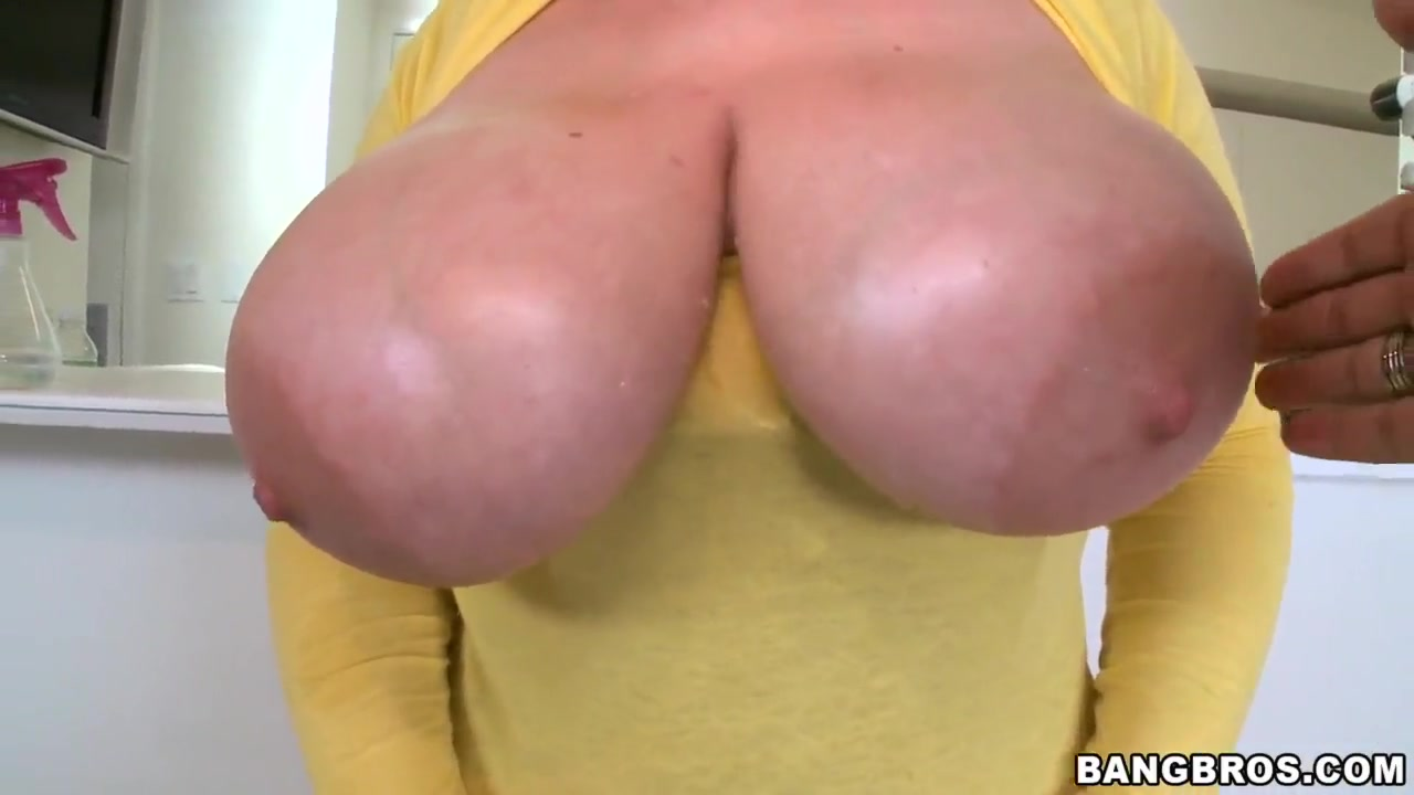 Blonde Tiffany Blake plays with her gigantic tits